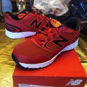 Brand new children's New Balance tennis shoes.